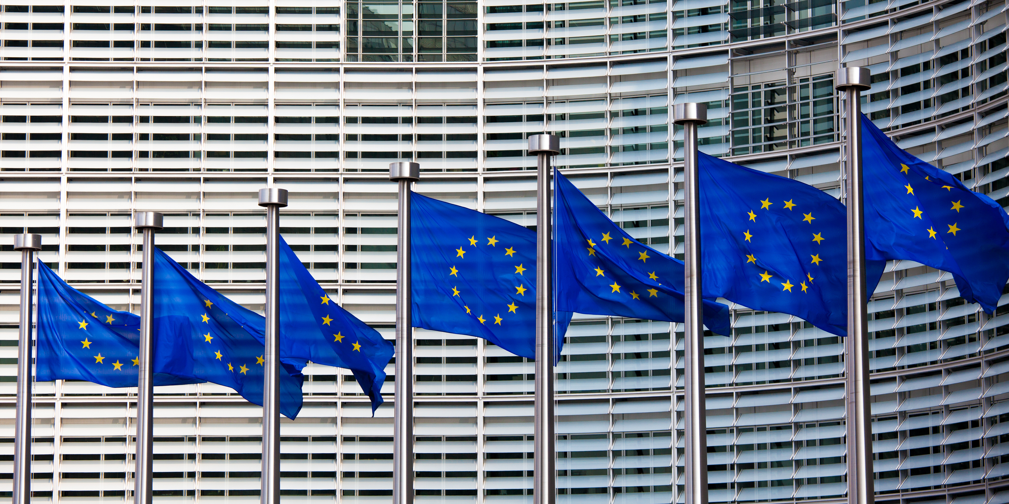 EU Flags flying in front of EU Commission in Brussels